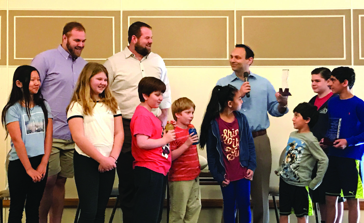 Mitchell and Geoff Schwartz, along with Rabbi Nolan Lebovitz, participate in a recent program at Adat Shalom. The Schwartzes attended religious school and became b'nai mitzvah there. Photo courtesy of Adat Shalom