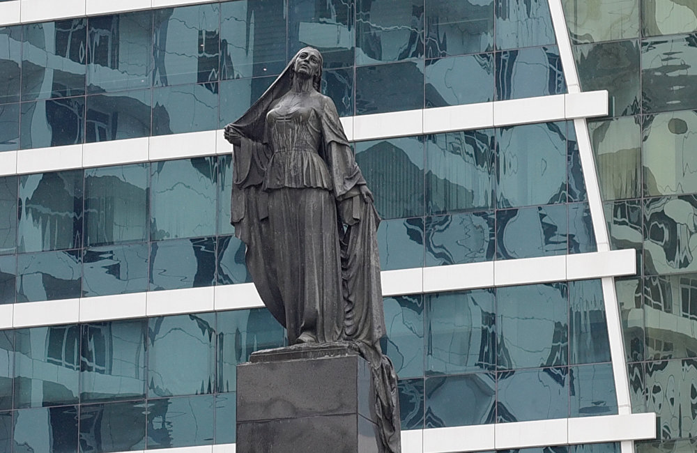 Statue of a Liberated Woman in Baku, Azerbaijan, depicting a woman who decides to remove her veil.
